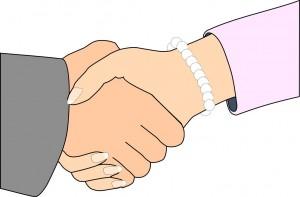 Två händer som skakar hand